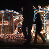 """People look at the holiday lighting display at 13941 Tincup Circle nicknamed the Christmas House.<br /> More photos please see  <a href=""""http://www.broomfieldenterprise.com"""">http://www.broomfieldenterprise.com</a><br /> December 9, 2011<br /> Staff photo/ David R. Jennings"""