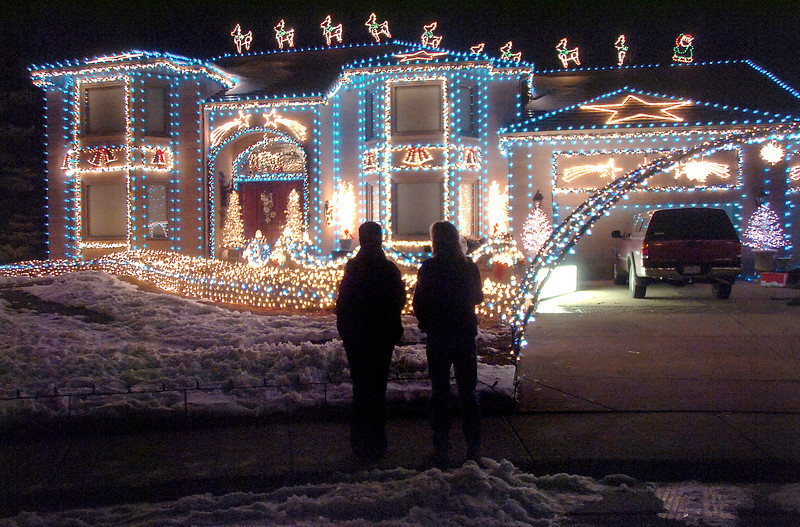 "People look at the holiday lighting display at 13941 Tincup Circle nicknamed the Christmas House.<br /> More photos please see  <a href=""http://www.broomfieldenterprise.com"">http://www.broomfieldenterprise.com</a><br /> December 9, 2011<br /> Staff photo/ David R. Jennings"