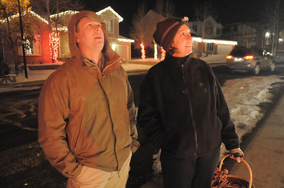 Brian Dieke, left, looks at the lighting display with owner Kim Weibert who's holiday lighting display is at 1188 Clubhouse Drive. More photos please see www.broomfieldenterprise.com December 9, 2011 Staff photo/ David R. Jennings