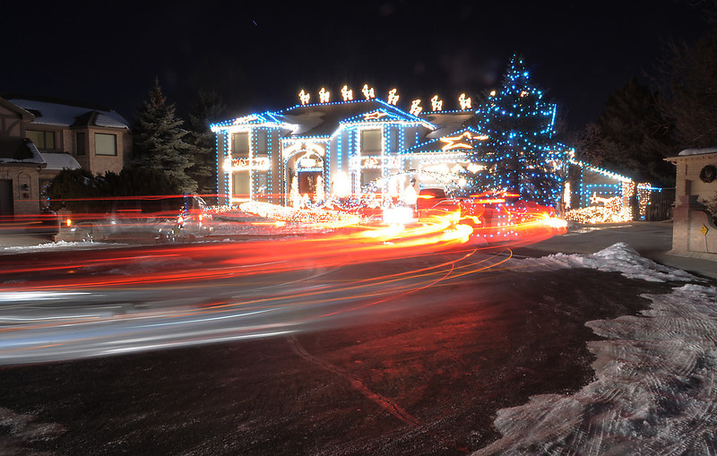 """Vehicle lights shine as people look at the holiday lighting display at 13941 Tincup Circle nicknamed the Christmas House.<br /> More photos please see  <a href=""""http://www.broomfieldenterprise.com"""">http://www.broomfieldenterprise.com</a><br /> December 9, 2011<br /> Staff photo/ David R. Jennings"""