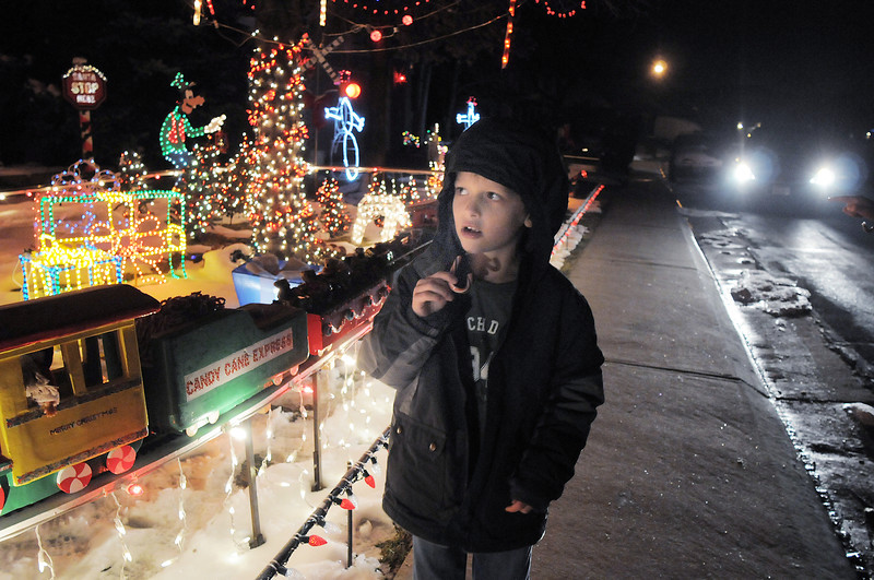"""Zachery Dieke, 6, looks at Kim Weibert's holiday lighting display at 1188 Clubhouse Drive.<br /> More photos please see  <a href=""""http://www.broomfieldenterprise.com"""">http://www.broomfieldenterprise.com</a><br /> December 9, 2011<br /> Staff photo/ David R. Jennings"""