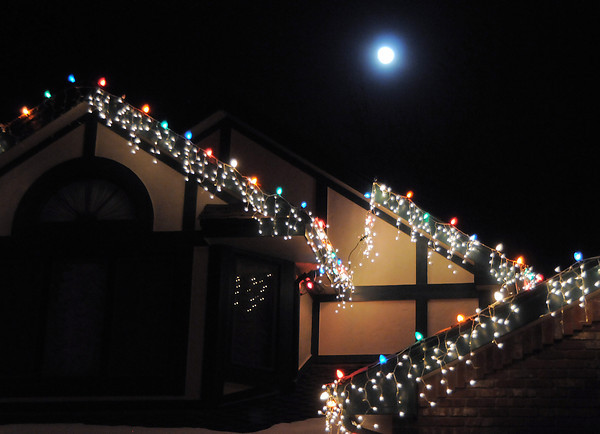 """The moon shines over the holiday lighting display at 13920 Tincup Circle.<br /> More photos please see  <a href=""""http://www.broomfieldenterprise.com"""">http://www.broomfieldenterprise.com</a><br /> December 8, 2011<br /> Staff photo/ David R. Jennings"""
