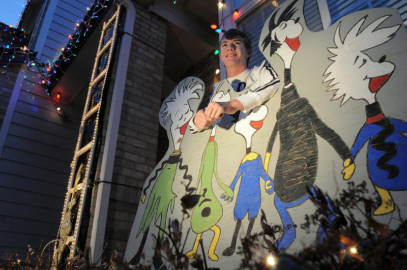 Ryan Smith, 16, poses behind Whoville characters he hep make for the family's holiday decorations at 4745 128th Place on Wednesday. <br /> December 15, 2010<br /> staff photo/David R. Jennings