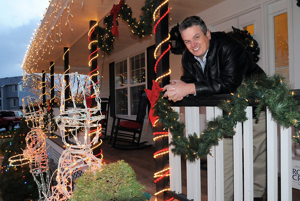 Rick Hill leans on the railing of his home at 4755 128th Place on Wednesday. <br /> December 15, 2010<br /> staff photo/David R. Jennings