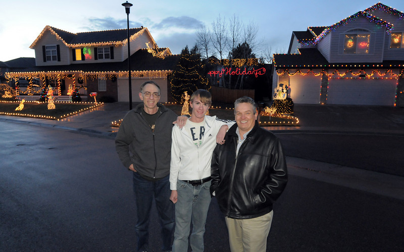 Neighbors Mike Smith and his son Ryan, 16, left, pose with Rick Hill in front of their houses on Wednesday. Hill's home is on the left, 4755 128th Place and the Smith's is right 4745 128th Place.<br /> December 15, 2010<br /> staff photo/David R. Jennings