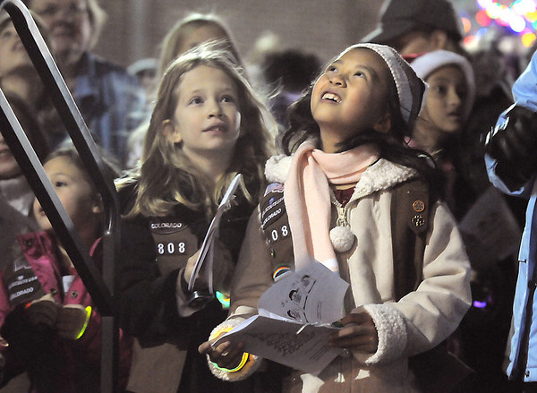 BE1205betree21<br /> Maya Chao, 7, right,  with Brownie Troop 2808, watches the helicopter fly over head carrying Santa during the Holiday Tree Lighting Ceremony at the Broomfield City and County Building on Friday.<br /> <br /> December 3, 2010<br /> staff photo/David R. Jennings