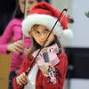 BE1205betree02<br /> Brooke Ferrel, 6, plays the violin with the Suzuki Violin Students during the Holiday Tree Lighting Ceremony at the Broomfield City and County Building on Friday.<br /> <br /> December 3, 2010<br /> staff photo/David R. Jennings