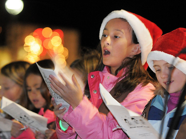 BE1205betree19<br /> Caitlin Johnnides, 8, sings carols with Brownie Troop 2808 during the Holiday Tree Lighting Ceremony at the Broomfield City and County Building on Friday.<br /> <br /> December 3, 2010<br /> staff photo/David R. Jennings
