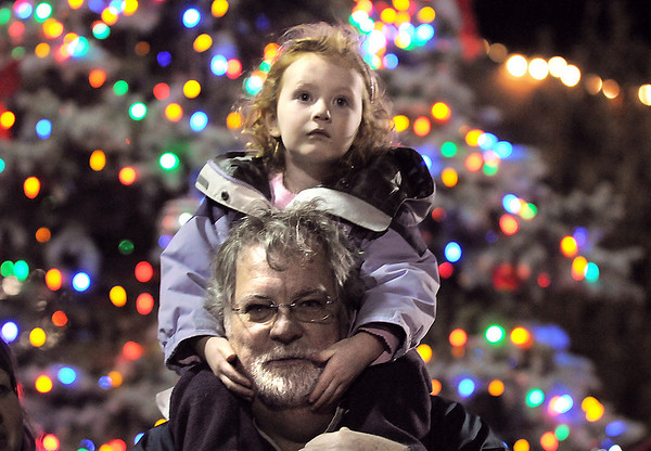 BE1205betree03<br /> Kensie Kirby, 3, sits on her father, Kerry, shoulders while listening to carols after the Mayor Pat Quinn lit the holiday  tree behind them during the Holiday Tree Lighting Ceremony at the Broomfield City and County Building on Friday.<br /> <br /> December 3, 2010<br /> staff photo/David R. Jennings