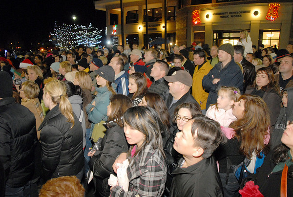 BE1205betree17<br /> The crowd listens to the Kohl Elementary Choir sing carols during the Holiday Tree Lighting Ceremony at the Broomfield City and County Building on Friday.<br /> <br /> December 3, 2010<br /> staff photo/David R. Jennings