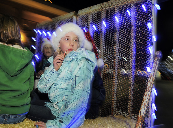 BE1205betree08<br /> Cassidy Sutton, 11, licks a candy cane while taking a hayride during the Holiday Tree Lighting Ceremony at the Broomfield City and County Building on Friday.<br /> <br /> December 3, 2010<br /> staff photo/David R. Jennings