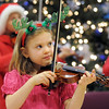 BE1205betree01<br /> Sofia Calavitta, 6, plays with the Suzuki Violin Students during the Holiday Tree Lighting Ceremony at the Broomfield City and County Building on Friday.<br /> <br /> December 3, 2010<br /> staff photo/David R. Jennings