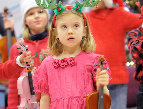 BE1205betree06<br /> Sofia Calavitta, 6, waits to play her violin with the Suzuki Violin Students during the Holiday Tree Lighting Ceremony at the Broomfield City and County Building on Friday.<br /> <br /> December 3, 2010<br /> staff photo/David R. Jennings