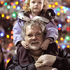 BE1205betree04<br /> Kensie Kirby, 3, sits on her father, Kerry, shoulders while listening to carols after the Mayor Pat Quinn lit the holiday  tree behind them during the Holiday Tree Lighting Ceremony at the Broomfield City and County Building on Friday.<br /> <br /> <br /> December 3, 2010<br /> staff photo/David R. Jennings