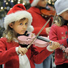 BE1205betree14<br /> Brooke Ferrel, 6, plays the violin with the Suzuki Violin Students during the Holiday Tree Lighting Ceremony at the Broomfield City and County Building on Friday.<br /> <br /> December 3, 2010<br /> staff photo/David R. Jennings