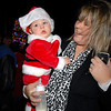 BE1205betree13<br /> Bridget Knight dressed her son Breyden, 8 months old in a santa suit for the Holiday Tree Lighting Ceremony at the Broomfield City and County Building on Friday.<br /> <br /> December 3, 2010<br /> staff photo/David R. Jennings