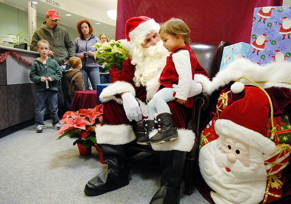 BE1205betree07<br /> Alyssa Pfrogner, 2, talks to Santa after the Holiday Tree Lighting Ceremony at the Broomfield City and County Building on Friday.<br /> <br /> December 3, 2010<br /> staff photo/David R. Jennings