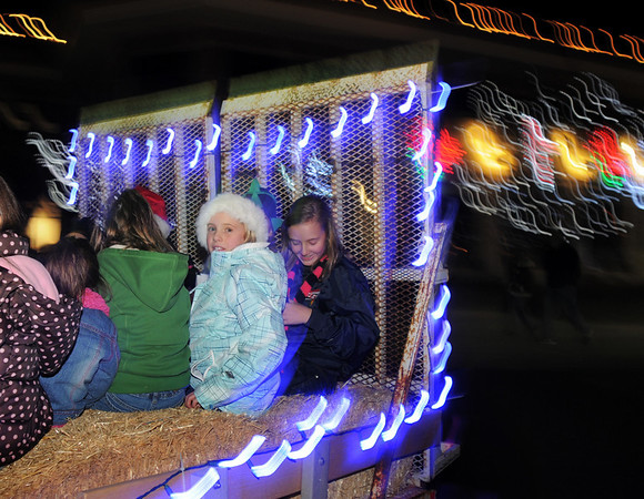 BE1205betree09<br /> Cassidy Sutton, 11, and Lainey Hughes, 10, ride with their friends on the hay ride after the Holiday Tree Lighting Ceremony at the Broomfield City and County Building on Friday.<br /> <br /> December 3, 2010<br /> staff photo/David R. Jennings