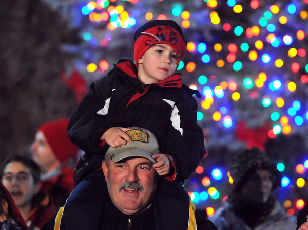 Christian  Leone, 4 1/2, sits on his father, Bert, shoulders in front of the Mayor's Holiday tree to get a better view of Santa arriving by helicopter during the Holiday Tree Lighting Ceremony at the Broomfield City and County Building on Friday. <br /> December 4, 2009<br /> Staff photo/David R. Jennings