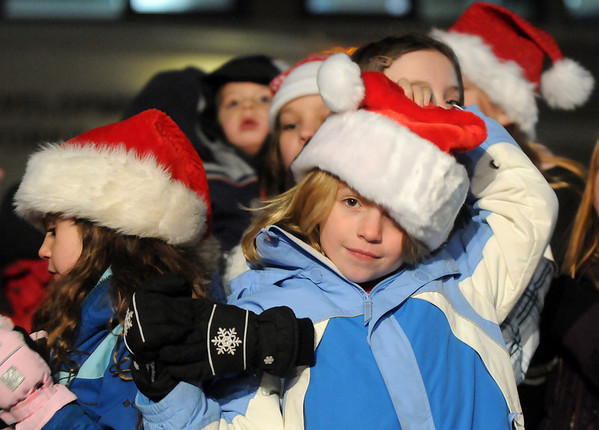 Rhys Hayzlett, 9, adjusts her hat before singing with the Kohl Elementary School choir at the Holiday Tree Lighting Ceremony at the Broomfield City and County Building on Friday<br /> December 4, 2009<br /> Staff photo/David R. Jennings