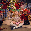 Sofia Calavitia, 5, center, looks around before preforming with the Suzuki Violin Students at the Holiday Tree Lighting Ceremony at the Broomfield City and County Building on Friday.<br /> December 4, 2009<br /> Staff photo/David R. Jennings