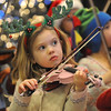 Sofia Calavitia, 5, plays with the Suzuki Violin Students at the Holiday Tree Lighting Ceremony at the Broomfield City and County Building on Friday.<br /> December 4, 2009<br /> Staff photo/David R. Jennings