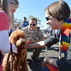 Rev. Kim Seidman blesses Ceili with owner RJane Snell,  during the Blessing of the Animals at Holy Comforter Episcopal Church on Saturday. Scout leader Jim Herbolsheimer of Troop 311 who's scouts were helping out for the day.<br /> September 29, 2012<br /> staff photo/ David R. Jennings