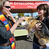 Rev. Kim Seidman blesses Winston held by owner Rhoda Marshall, during the Blessing of the Animals at Holy Comforter Episcopal Church on Saturday.<br /> September 29, 2012<br /> staff photo/ David R. Jennings
