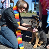Rev. Kim Seidman blesses 3 month old Magic a German Shepard owned by Donna Frank  during the Blessing of the Animals at Holy Comforter Episcopal Church on Saturday.<br /> September 29, 2012<br /> staff photo/ David R. Jennings