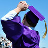 A graduate celebrates after receiving his diploma during Holy Family High School's 87th Annual Commencement at Mike G. Gabriel Stadium on Thursday.<br /> <br /> May 24, 2012 <br /> staff photo/ David R. Jennings