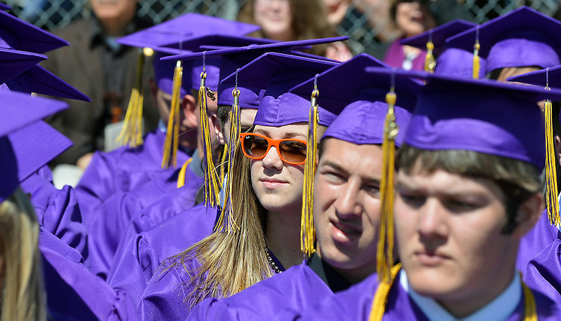 Cassidy Gills wore her red sunglasses during Holy Family High School's 87th Annual Commencement at Mike G. Gabriel Stadium on Thursday.<br /> <br /> May 24, 2012 <br /> staff photo/ David R. Jennings