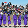 The 141 graduates line up to take their seats during Holy Family High School's 87th Annual Commencement at Mike G. Gabriel Stadium on Thursday.<br /> <br /> May 24, 2012 <br /> staff photo/ David R. Jennings