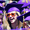 Cassidy Gills wearing red sunglasses gives a cheer to fellow graduates during Holy Family High School's 87th Annual Commencement at Mike G. Gabriel Stadium on Thursday.<br /> May 24, 2012 <br /> staff photo/ David R. Jennings