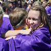 Alexa Brown hugs Bryan Oldham after Holy Family High School's 2012 Commencement at Mike G. Gabriel Stadium on Thursday.<br /> <br /> May 24, 2012 <br /> staff photo/ David R. Jennings