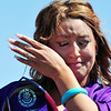 Jordan DiTirro cries while receiving a special award fro the Sisters of Loretto during Holy Family High School's 87th Annual Commencement at Mike G. Gabriel Stadium on Thursday. The Sisters of Loretto founded the school in the 1920's.<br /> <br /> May 24, 2012 <br /> staff photo/ David R. Jennings