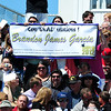 The family of Brendan Garcia hold up a sign in celebration of recieving his diploma during Holy Family High School's 87th Annual Commencement at Mike G. Gabriel Stadium on Thursday.<br /> <br /> May 24, 2012 <br /> staff photo/ David R. Jennings