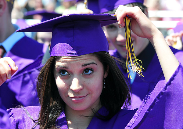 Megan Chavez truns her tassel during Holy Family High School's 87th Annual Commencement at Mike G. Gabriel Stadium on Thursday.<br /> <br /> May 24, 2012 <br /> staff photo/ David R. Jennings