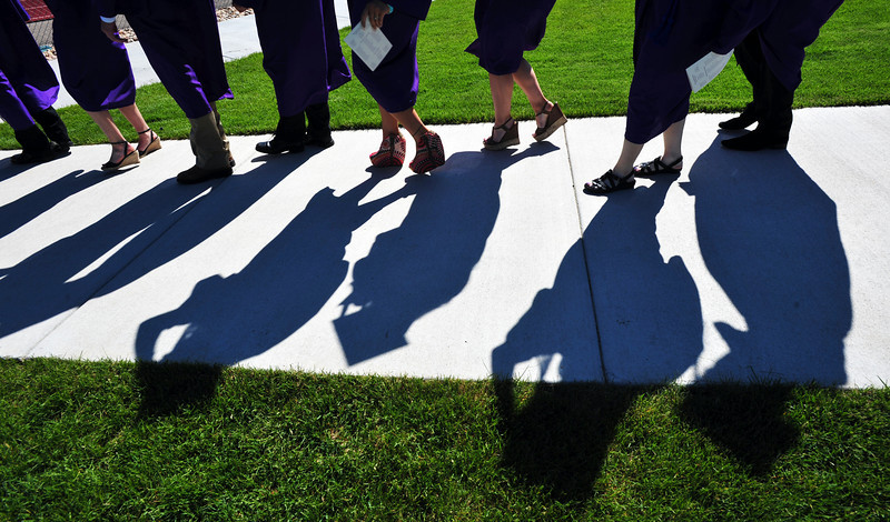 Graduates march in to Mike G. Gabriel Stadium for Holy Family High School's first outdoor commencement ceremony on Thursday.<br /> <br /> May 24, 2012 <br /> staff photo/ David R. Jennings