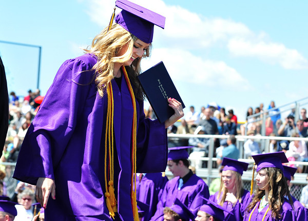 Stephanie Giltner smiles after receiving her diploma during Holy Family High School's 87th Annual Commencement at Mike G. Gabriel Stadium on Thursday.<br /> <br /> May 24, 2012 <br /> staff photo/ David R. Jennings