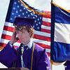 Salutatorian Braeden Fallet delivers his speech while hanging on to his cap during Holy Family High School's 87th Annual Commencement at Mike G. Gabriel Stadium on Thursday.<br /> <br /> May 24, 2012 <br /> staff photo/ David R. Jennings