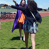 Graduate Blaire Mikesell, left, raises her arms to hug alum Carolina Guieterrez after Holy Family High School's 87th Annual Commencement at Mike G. Gabriel Stadium on Thursday.<br /> <br /> May 24, 2012 <br /> staff photo/ David R. Jennings