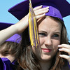 Stefanie Fromholzer steadies her cap in the wind before Holy Family High School's 87th Annual Commencement at Mike G. Gabriel Stadium on Thursday.<br /> <br /> May 24, 2012 <br /> staff photo/ David R. Jennings