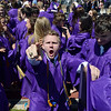 Bryan Oldham gives a cheer after Holy Family High School's 87th Annual Commencement at Mike G. Gabriel Stadium on Thursday.<br /> <br /> May 24, 2012 <br /> staff photo/ David R. Jennings