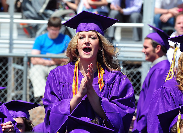 Stephanie Giltner cheers fellow graduates receiving their diplomas during Holy Family High School's 87th Annual Commencement at Mike G. Gabriel Stadium on Thursday.<br /> <br /> May 24, 2012 <br /> staff photo/ David R. Jennings