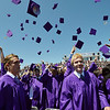 Graduates toss their caps in the air after Holy Family High School's 87th Annual Commencement at Mike G. Gabriel Stadium on Thursday.<br /> <br /> May 24, 2012 <br /> staff photo/ David R. Jennings