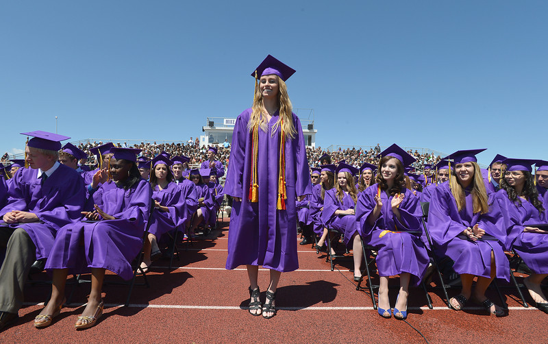 McKenzie Zeman waits to recieve the last diploma of Holy Family High School's 2012 Commencement at Mike G. Gabriel Stadium on Thursday.<br /> <br /> May 24, 2012 <br /> staff photo/ David R. Jennings