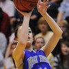 Holy Family's Taylor Helbig shoots for three against Colorado Springs Christian during Saturday's 3A state championship game at CSU's Moby Gym.<br /> <br /> <br /> March 13, 2010<br /> Staff photo/David R. Jennings