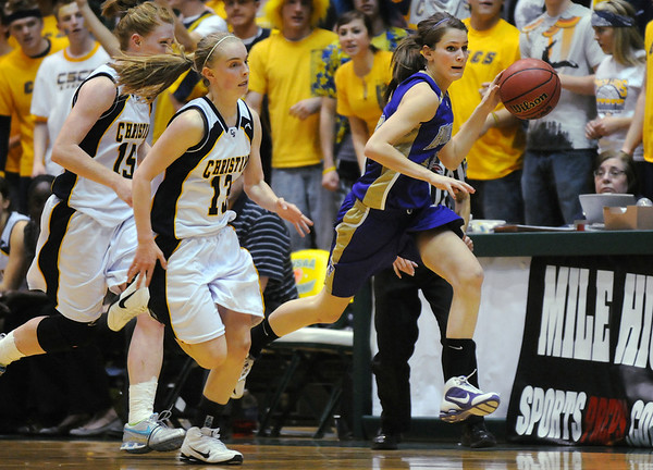 Holy Family's Alex Wilson drives the ball down court ahead of Colorado Springs Christian's Brianne Vande Griend and Sarah Gruhl during Saturday's 3A state championship game at CSU's Moby Gym.<br /> <br /> <br /> March 13, 2010<br /> Staff photo/David R. Jennings