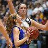 Holy Family's Stephanie Giltner goes for a lay up against Colorado Springs Christian's Erika Hekman during Saturday's 3A state championship game at CSU's Moby Gym.<br /> <br /> <br /> March 13, 2010<br /> Staff photo/David R. Jennings
