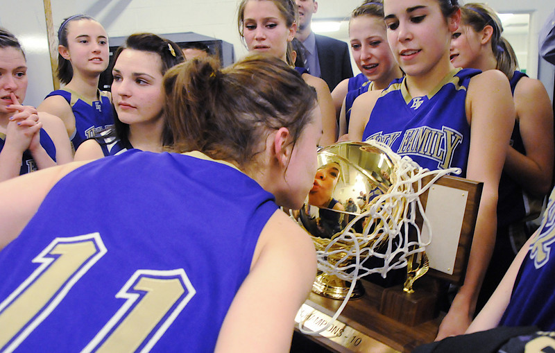 Taylor Helbig kisses the state 3A state trophy after Holy Family's third  3A state championship defeating Colorado Springs Christian after Saturday's game at CSU's Moby Gym.<br /> <br /> <br /> March 13, 2010<br /> Staff photo/David R. Jennings